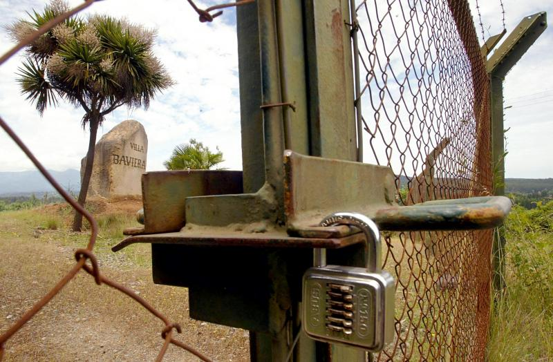 his file photo taken on November 22, 2004 shows the locked gate of the former entrance to Villa Baviera - formerly known as Colonia Dignidad (Dignity Colony), some 350 km south of Santiago.jpg