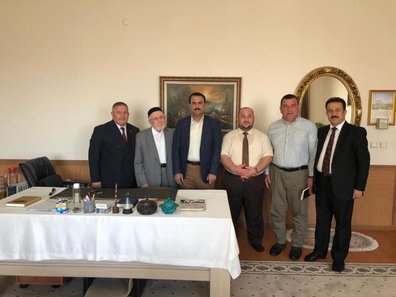 IKB heyeti cemaatin hocalarından Musa Emrikçi'yi ziyaret etti