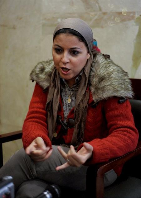 Mısır-6 Nisan Hareketi'nin kurucusu Esra Abdulfettah Tahrir Meydanı'nda protestocuların tanınmış siması haline geldi-foto Cem Özdel-Kaynak- Anad.jpg
