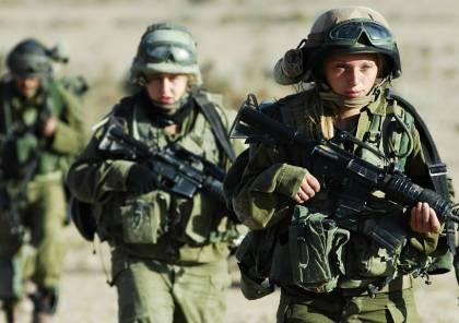 İsrailli kadın askerler tam teçhizat cephede .jpg