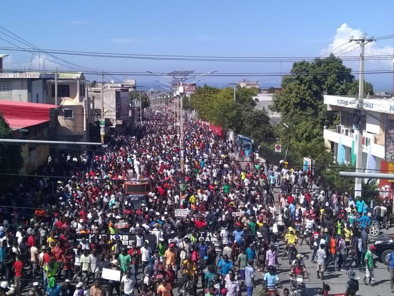 Ulusal yolsuzlukla mücadele gösterisi, La Saline katliamından beş gün sonra Fotoğraf Haiti Liberte.jpg