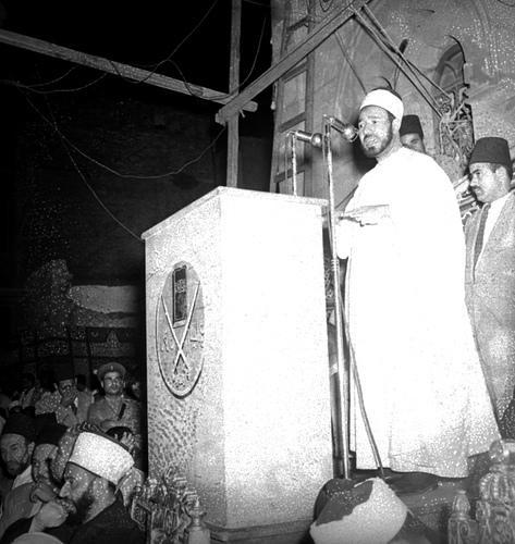 Hasan El Benne, bir konuşması sırasında-kaynak-Doğuhaber sitesi.jpg