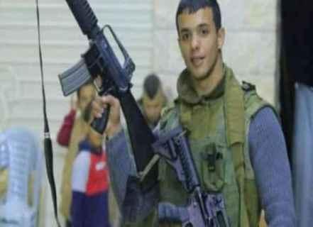 İsrail güçleriyle çatışmada öldürülen bir Filistinli gencin eski resmi.jpg