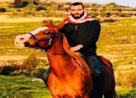 İsrail kolluk kuvvetleriyle çatışmada katledilen Filistinli gencin eski fotoğrafı.jpg